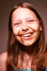 Teen girl with chocolate on her face