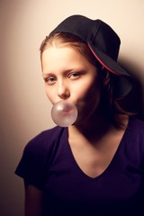 Teen girl blowing bubble