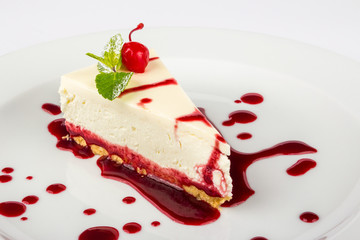 classic cheesecake in a raspberry