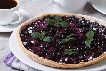 blueberry pie with mint and black coffee horizontal closeup
