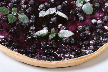 blueberry pie with mint and powdered sugar macro top view