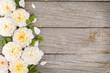 Obrazy na płótnie, fototapety, zdjęcia, fotoobrazy drukowane : Wooden background with fresh rose flowers