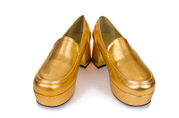 Golden woman shoes isolated on the white