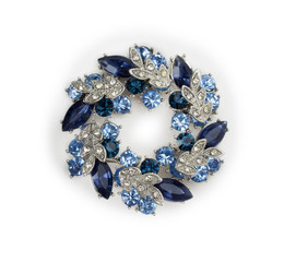 silver brooch with blue and white gemstones