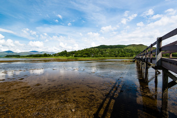 Scottish landscape with wooden footbridge