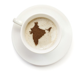 Cup of coffee with foam and powder in the shape of India.(series