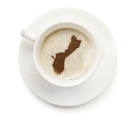 Cup of coffee with foam and powder in the shape of Guam.(series)