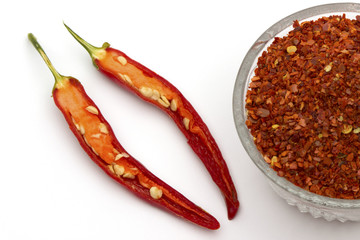 Red pepper flakes and fresh red hot chili peppers