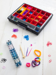 loom banding tools, hobby box and multicoloured elastic bands