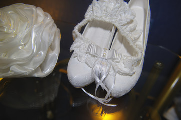 beautiful white bride's handbag and shoes on the table