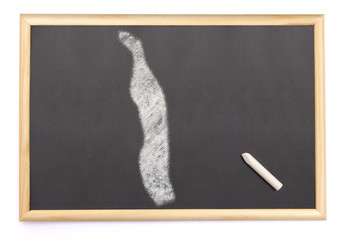 Blackboard with a chalk and the shape of Togo drawn onto. (serie