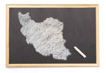 Blackboard with a chalk and the shape of Iran drawn onto. (serie