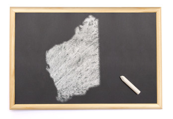 Blackboard with a chalk and the shape of Western Australia drawn