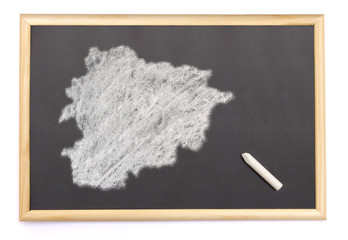 Blackboard with a chalk and the shape of Andorra drawn onto. (se
