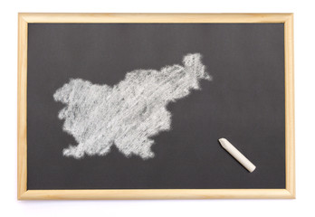 Blackboard with a chalk and the shape of Slovenia drawn onto. (s