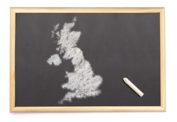 Blackboard with a chalk and the shape of United Kingdom drawn on