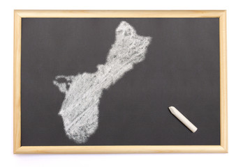 Blackboard with a chalk and the shape of Guam drawn onto. (serie