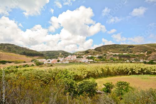 Fotobehang Vuurtoren / Mill Bordeira, ancient portuguese village Algarve coutryside Portugal