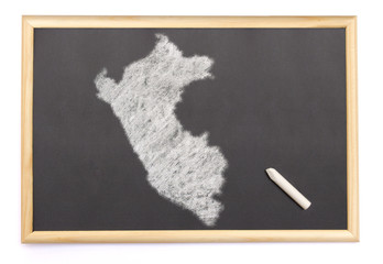 Blackboard with a chalk and the shape of Peru drawn onto. (serie