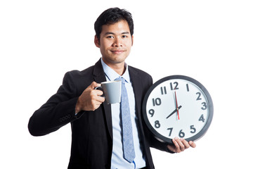 Asian office man smile with a clock and a cup of coffee
