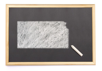 Blackboard with a chalk and the shape of Kansas drawn onto. (ser