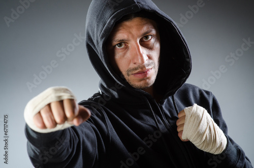 Staande foto Martial arts fighter at the training