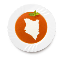 Plate tomato soup with cream in the shape of Kenya.(series)