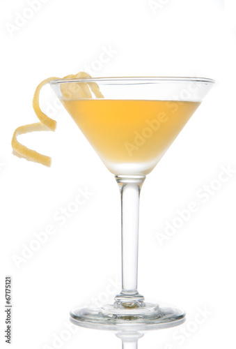 Fotobehang Cocktail Yellow banana cocktail in martini glass with lemon twist