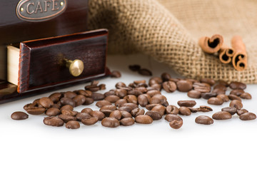 Coffee beans closeup with coffee mill