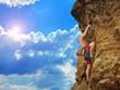 Young tourist climbing