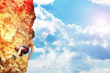 muscular man climbing