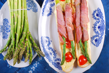 baguette with green asparagus wrapped in ham