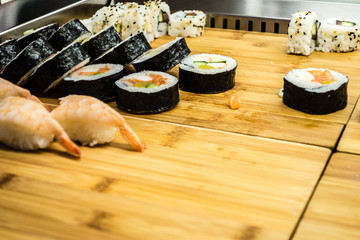 Sushi on wooden board