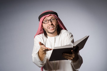 Arab student with book in education concept