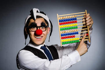 Funny clown with abacus in accounting concept