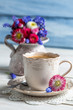 Closeup of daisy flowers and cup of coffee