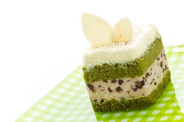 Matcha green tea cake isolated on white background