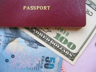Passport and currency focuses on us dollar.