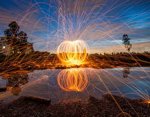 Burning steel wool fireworks