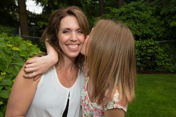 Teenager kissing Mom