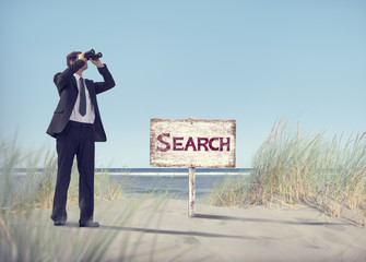 Businessman Holding Handheld Binocular with Signboard on Beach