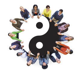 Multiethnic People Holding Hands with Yin Yang Symbol