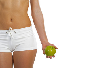 sporty woman with green apple