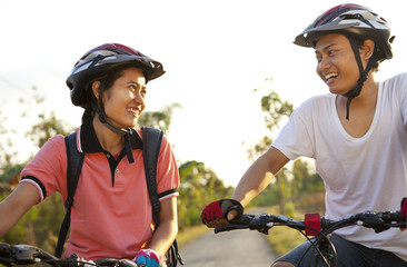 Young couple riding bike