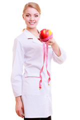 Woman doctor dietitian in lab coat recommending