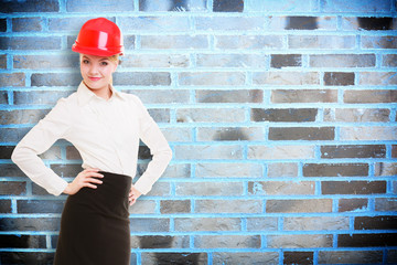 Female engineer woman architect in red helmet