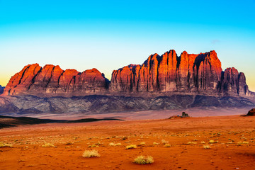 The Jebel Qatar Mountain in Wadi Rum, Jordan at twilight.