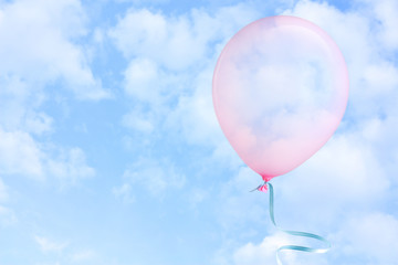 Pink balloon flying