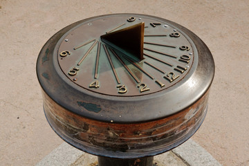Vintage solar clock showing time four o'clock