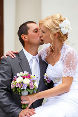 beautiful young wedding couple kissing